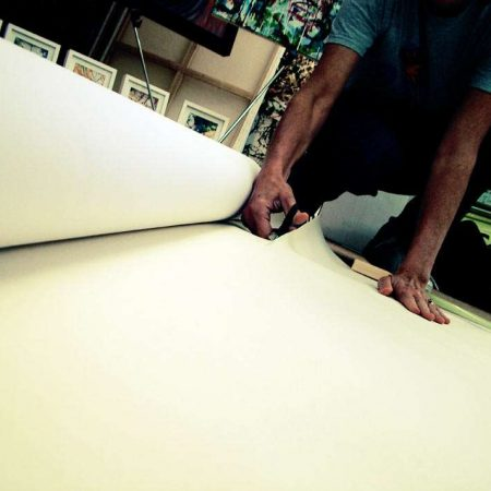 artist cutting canvas