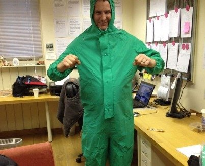 Adrian from Swarez Art in a green chemical suit