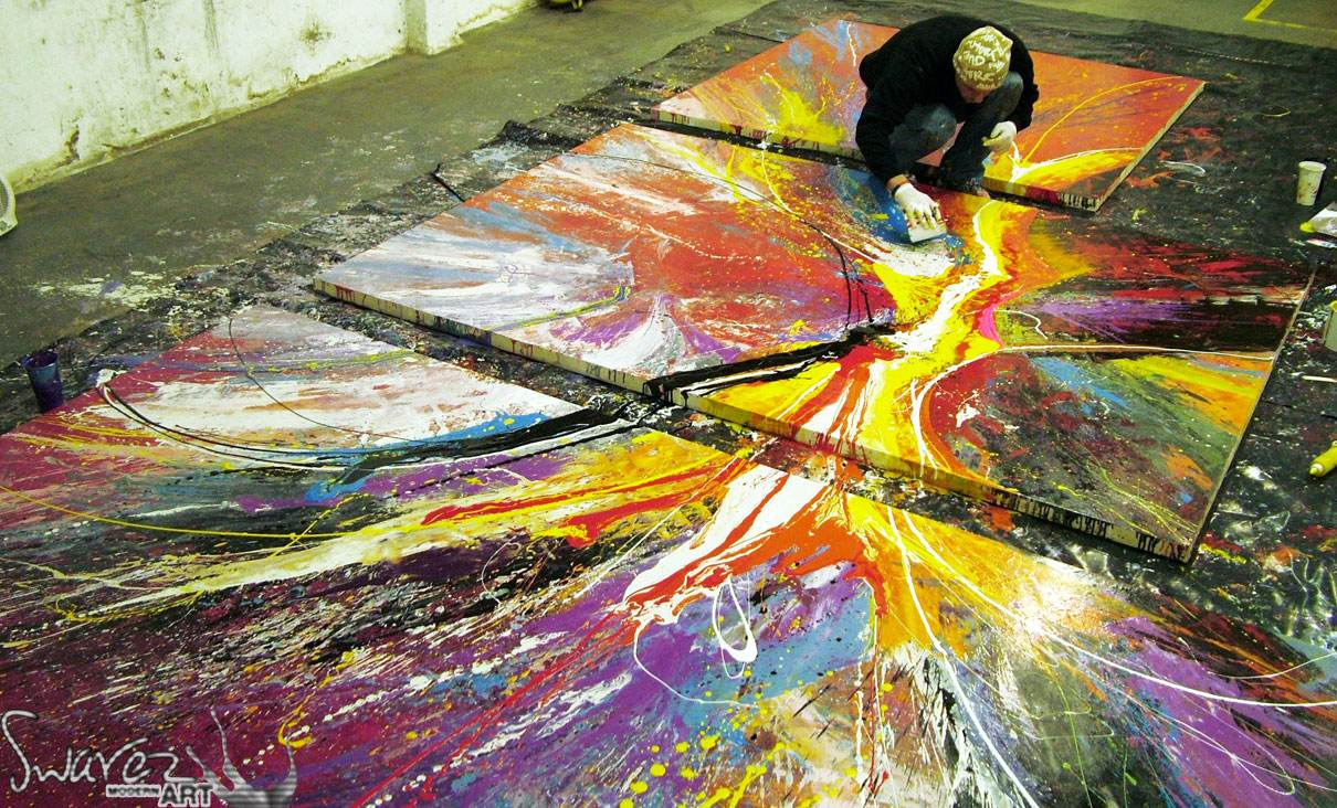 Painting-a-very-large-set-of-canvases