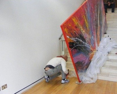 Unwrapping a big painting