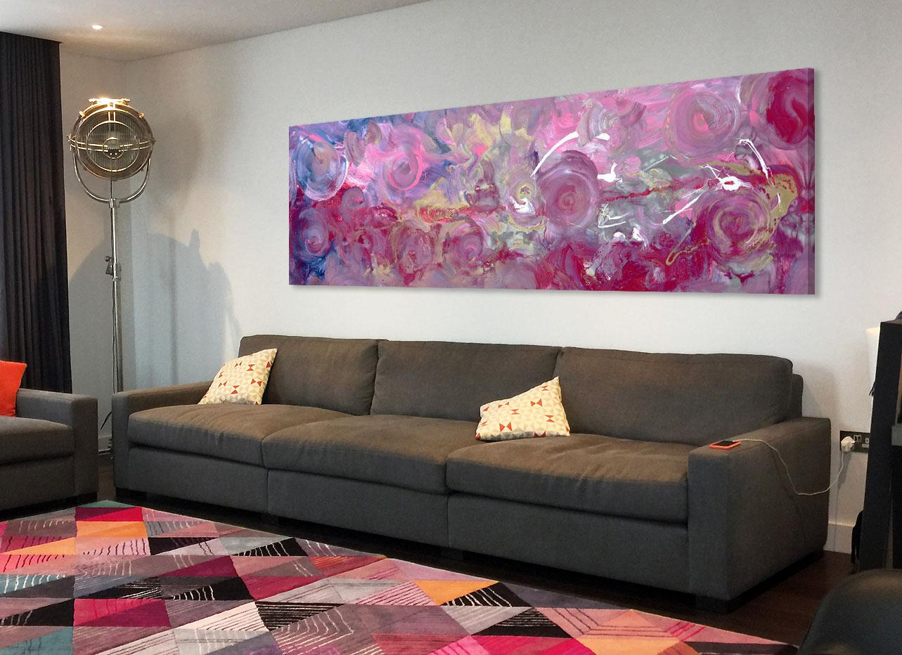 Large pink and gold painting above a grey sofa