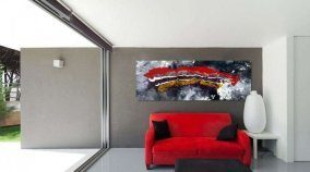 red black and purple art above a red sofa
