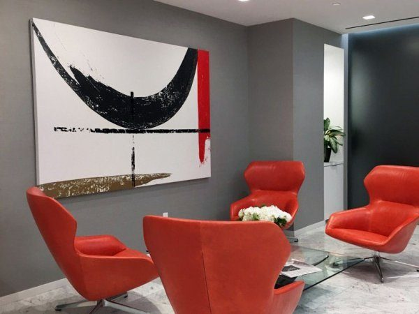 Red and white abstract painting in an office reception