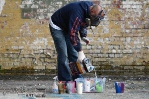 Pouring thinners into paint