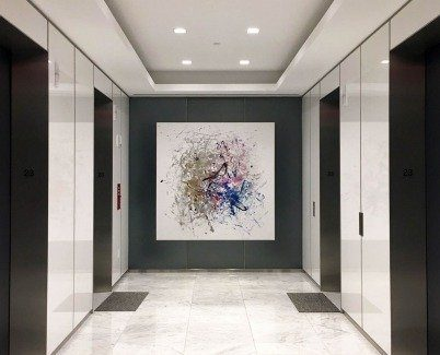 White and gold art in an elevator area