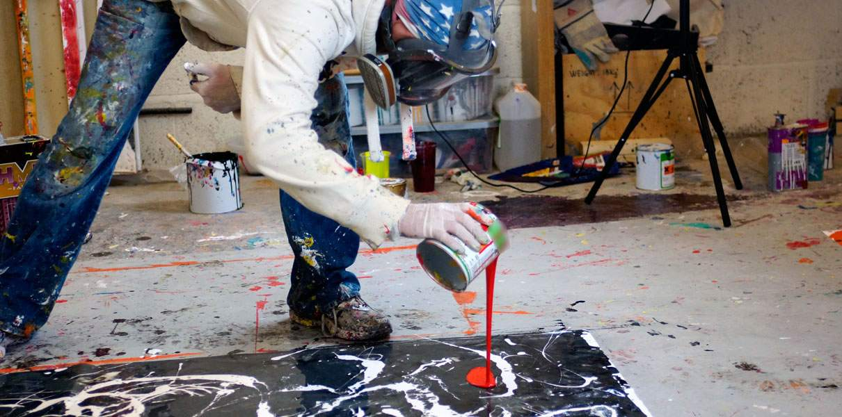 pouring paint from a can