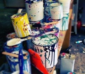 used cans of paint