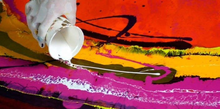 pouring white paint onto canvas