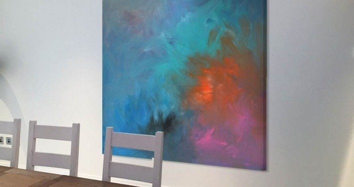 Blue pink and aqua painting in a dining room