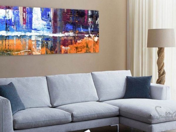 Art hanging above a sofa