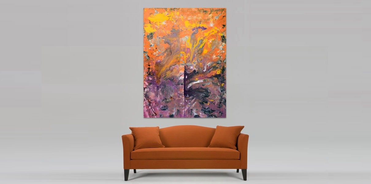 golden sofa with a painting hanging above it