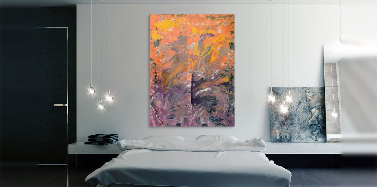 hanging art in a bedroom