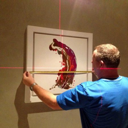hanging art with a laser level