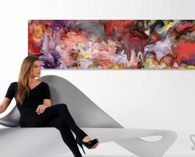 A long white room with a piece of art on one side