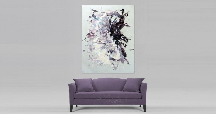 Light coloured painting hung above a dusky purple sofa