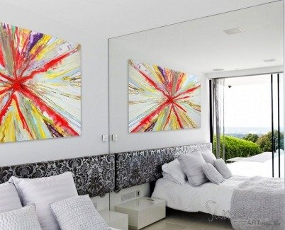 Big art on a wall in a bedroom with a reflection in a mirror