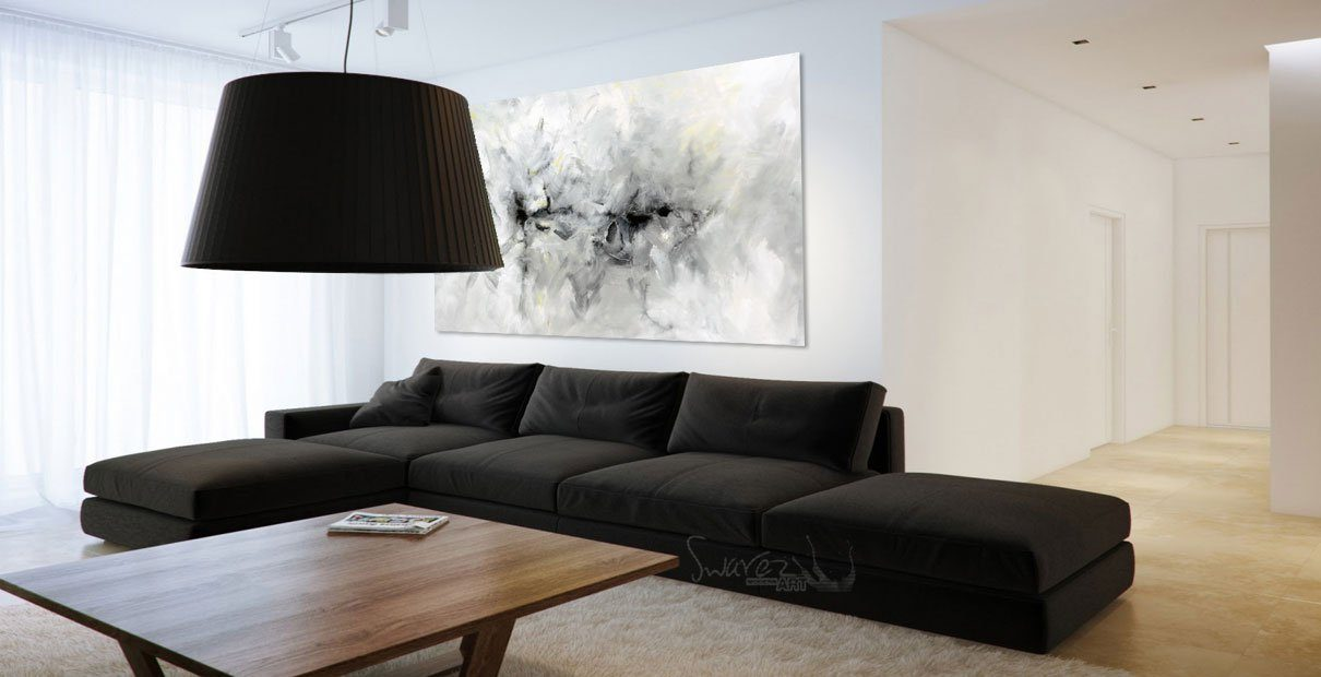 Dark coloured sofa in a minimal room with a big lampshade