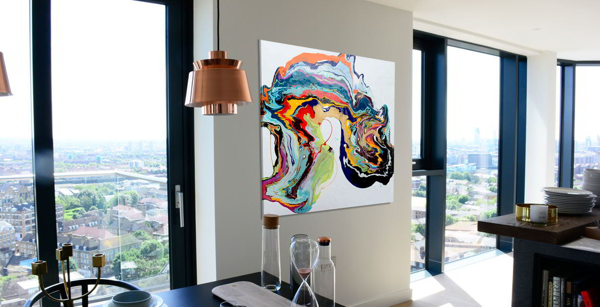 Square multi-coloured art hanging in a kitchen in a Penthouse