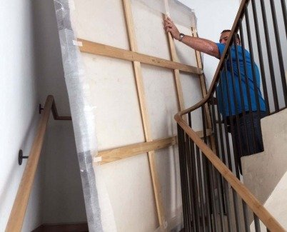 Carrying-a-large-painting-upstairs
