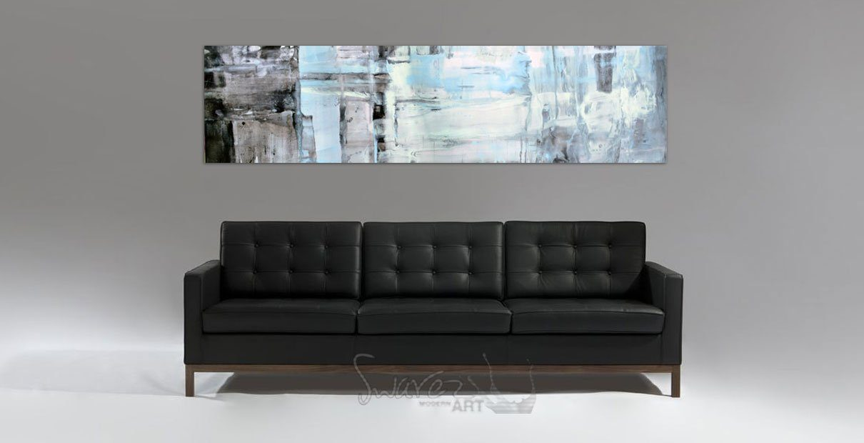 Italian leather sofa and art on a wall