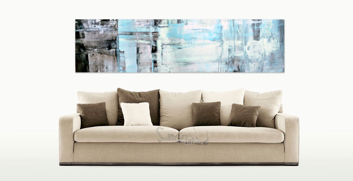 Taupe sofa featuring minimal art hanging above