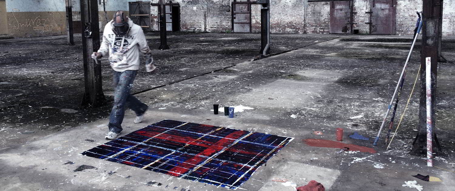Swarez painting tartan canvas in his studio