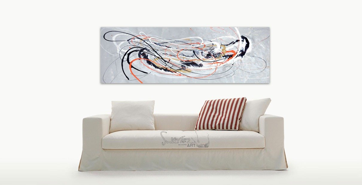 Orange and silver art and white sofa