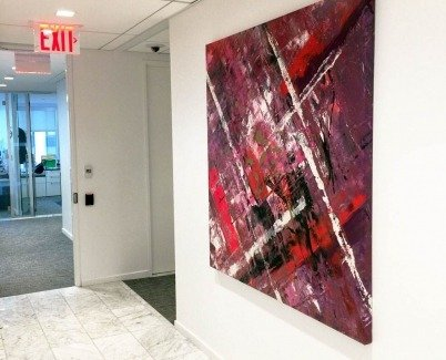 Pink and red painting in a corridor