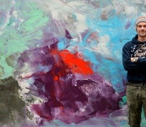 Stadning in front of a very large abstract canvas