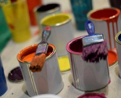 Brght coloured paint cans opened