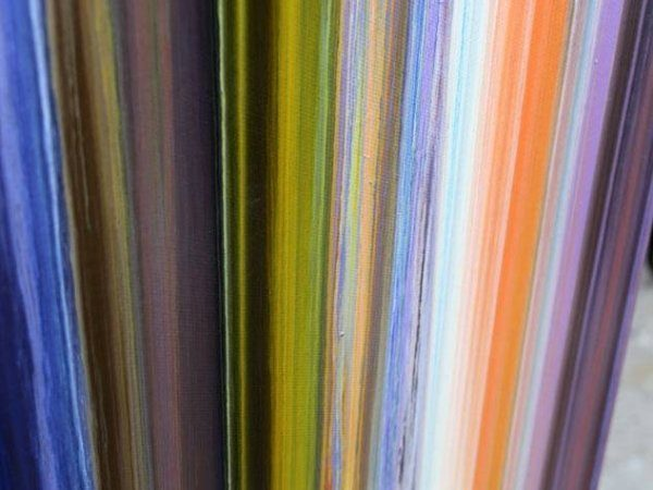Vertical lines of coloured paint