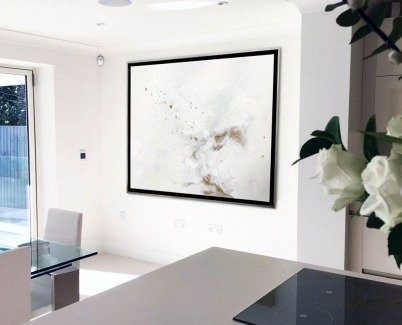 White minimal kitchen and a white and cream artwork