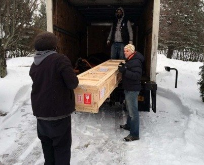 Swarez taking delivery of paintings in the snow