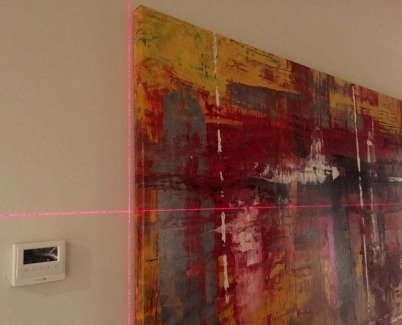 Lining up a painting with a laser level