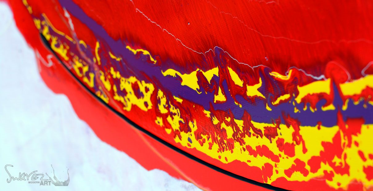 detailed view of red and yellow paints on canvas