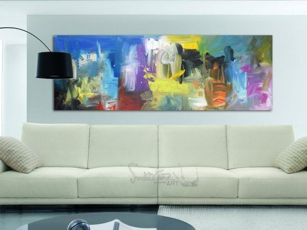 Forty Mile Town original painting above a cream leather sofa