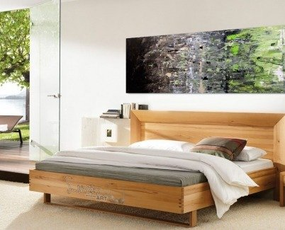 Gold and green art in a bedroom
