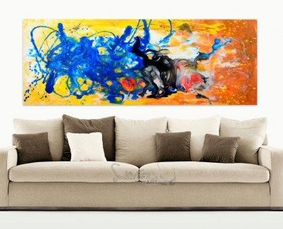 Light coloured sofa with art hanging