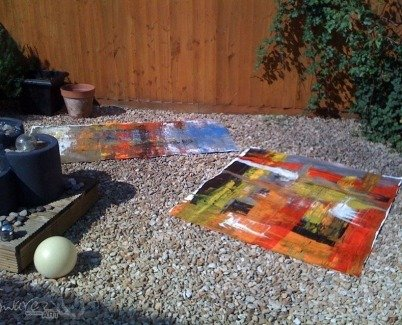 Doing two paintings in my back garden 2010
