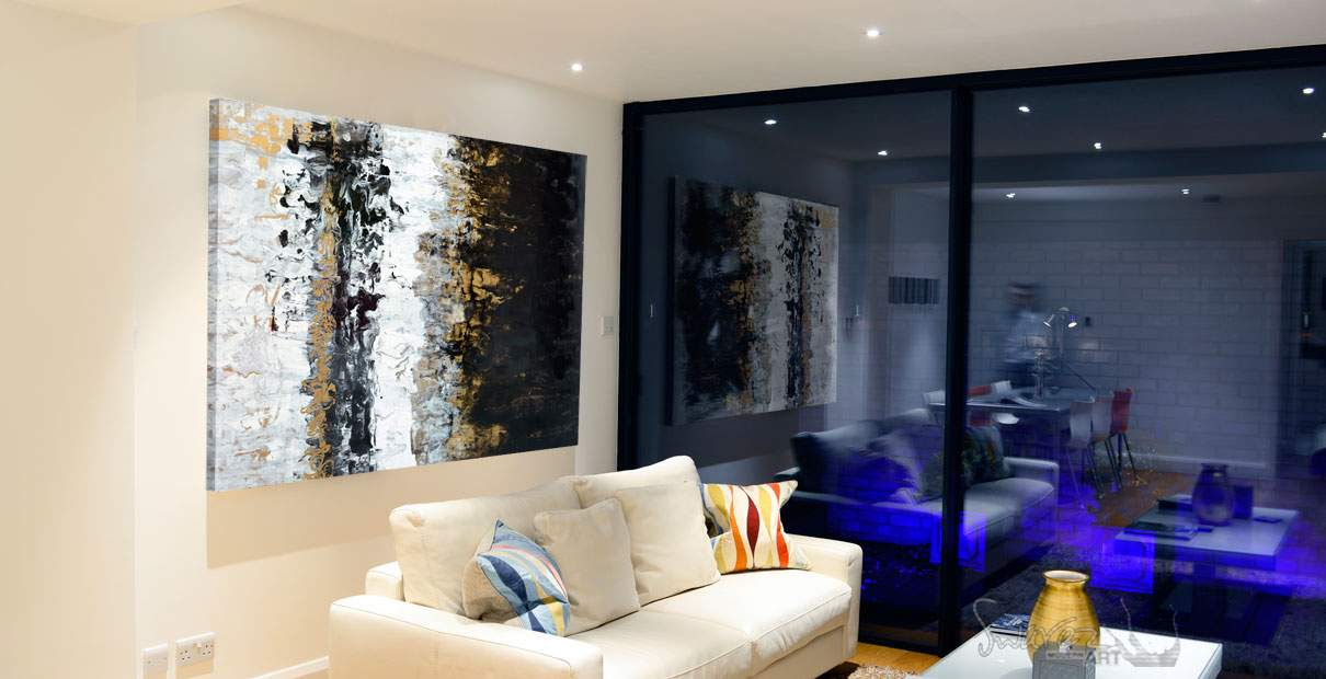 Gold coloured art in a contemporary living space