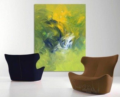 Large green and blue art behind two easy chairs