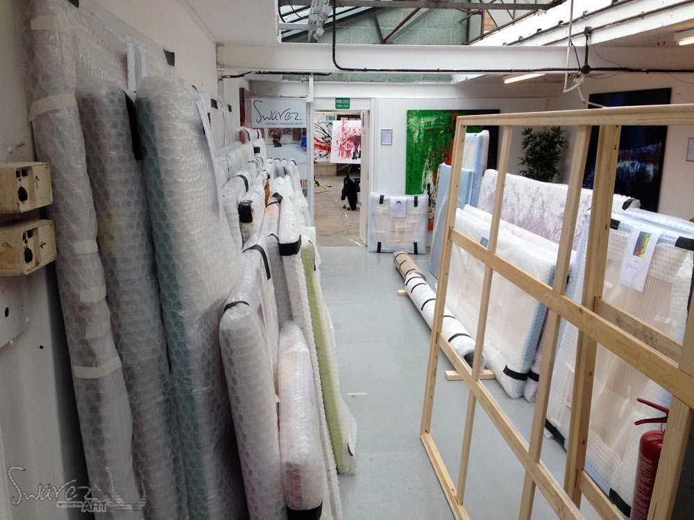 Paintings-wrapped-up-ready-for-shipping-to-Dubai