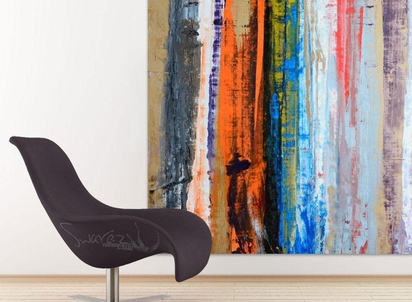 Big art hanging behind a curved designer chair