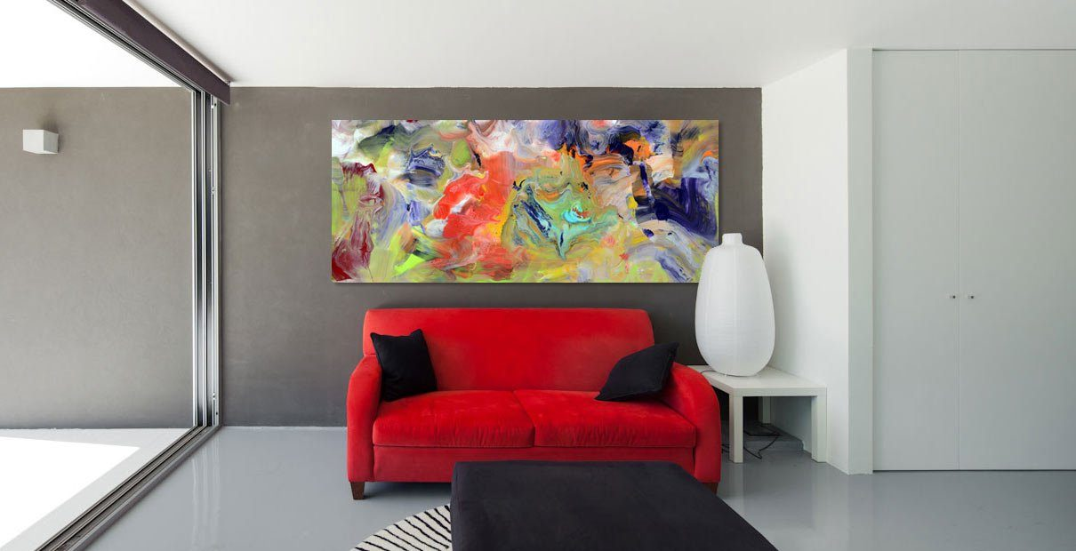 Contemporary red sofa with art hanging on a grey wall