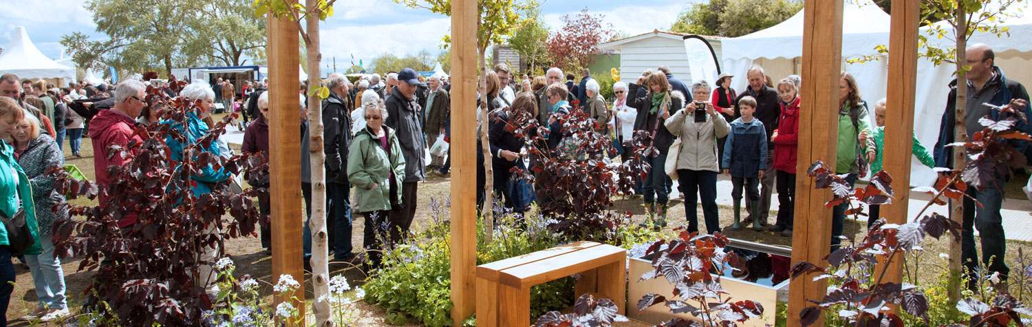 Crowds gathering around a designer garden by Garden Stories Ltd