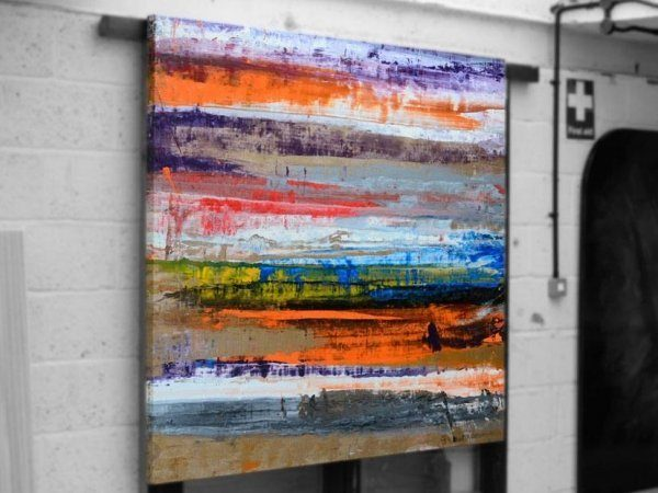 Large original modern art hanging in a warehouse