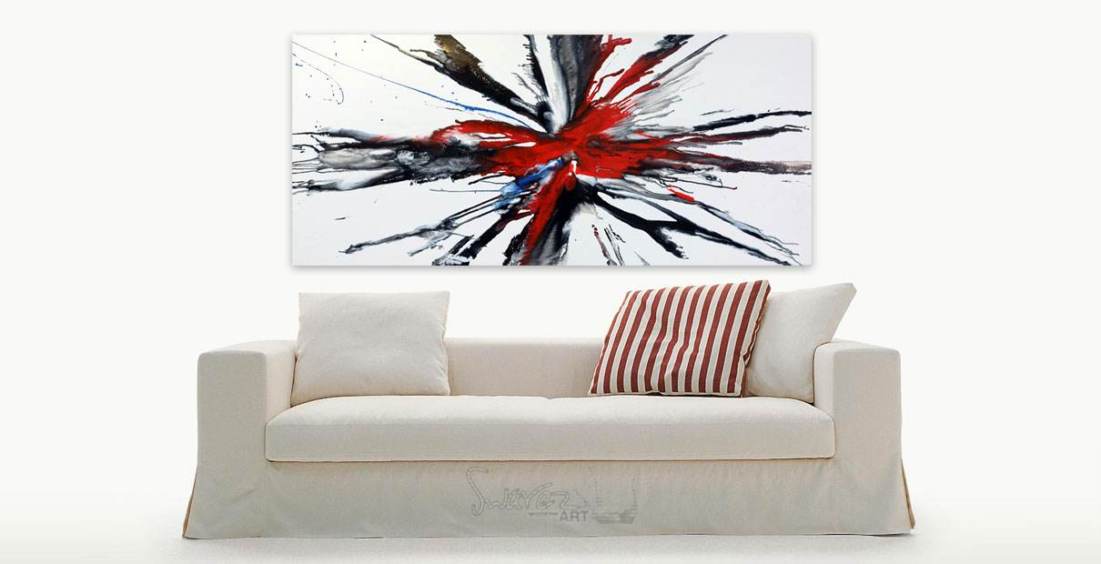 Systematic Chaos painting above a cream cloth sofa