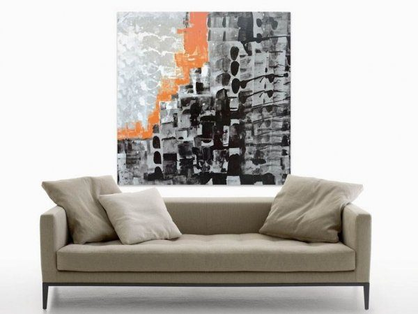 Beige sofa with a black and silver painting