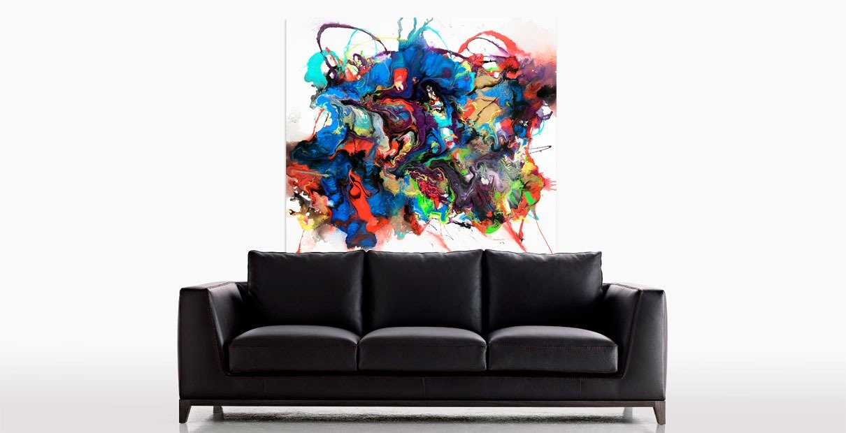 Art above a black leather sofa