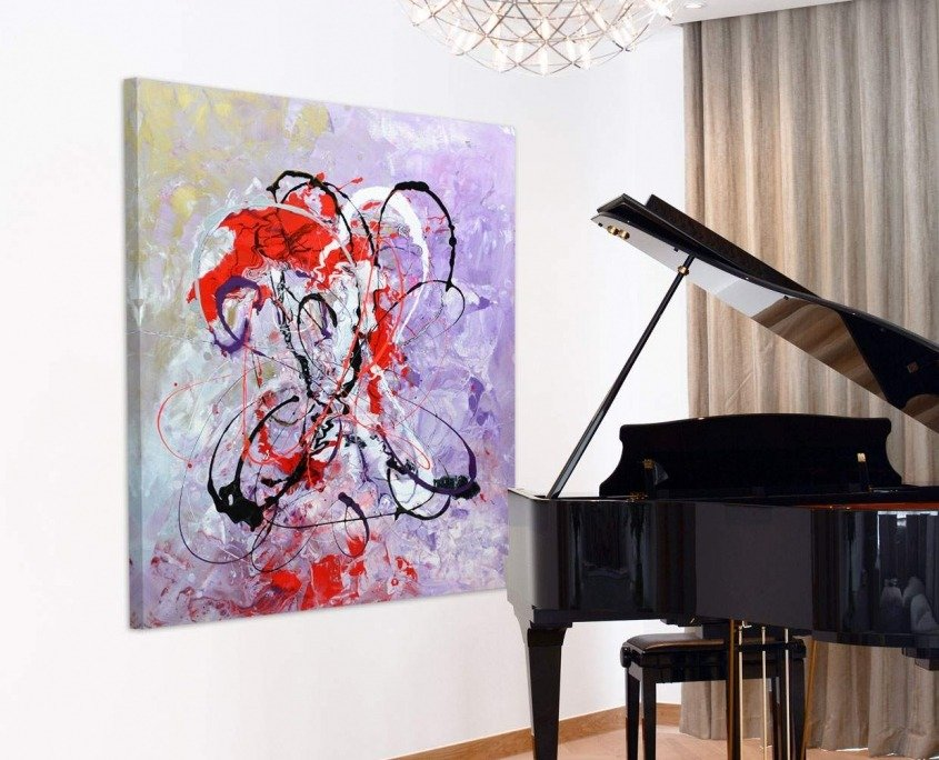 Red and purple art by a piano